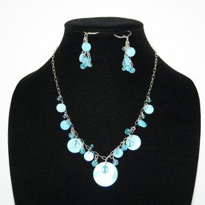 Silver and blue shell necklace and earring set